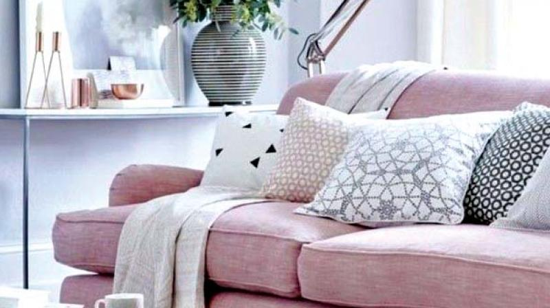 Quirk up your living room with millennial pink upholstery.