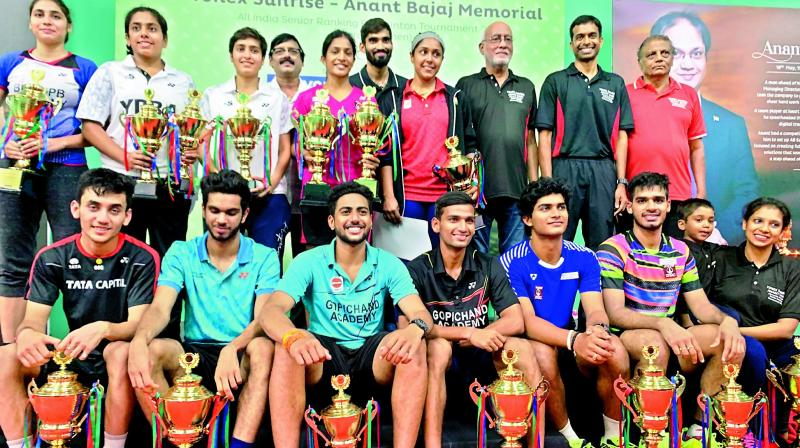 Winners of the All India Senior Ranking Badminton tournament pose with their trophies at the Pullela Gopichand Badminton Academy in Hyderabad on Sunday.