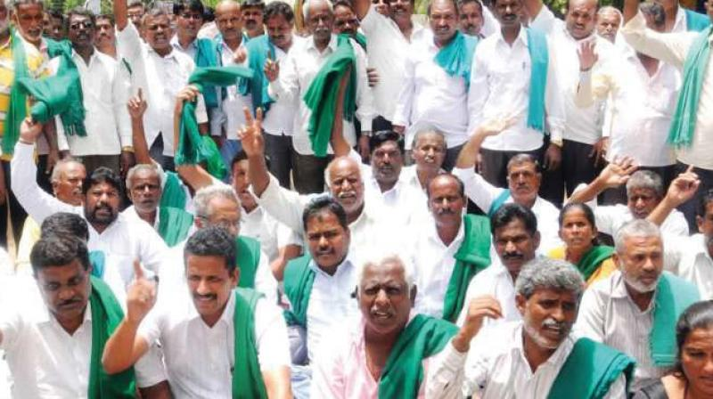 A file photo of farmers protesting demanding waiver of farmer loans.