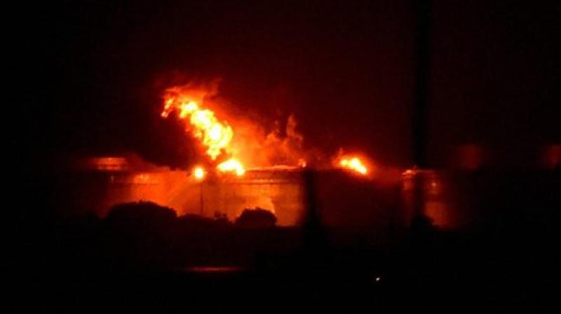 Fire breaks out at a oil depot on Butcher Island off the coast of Mumbai on Friday. (Photo: PTI)