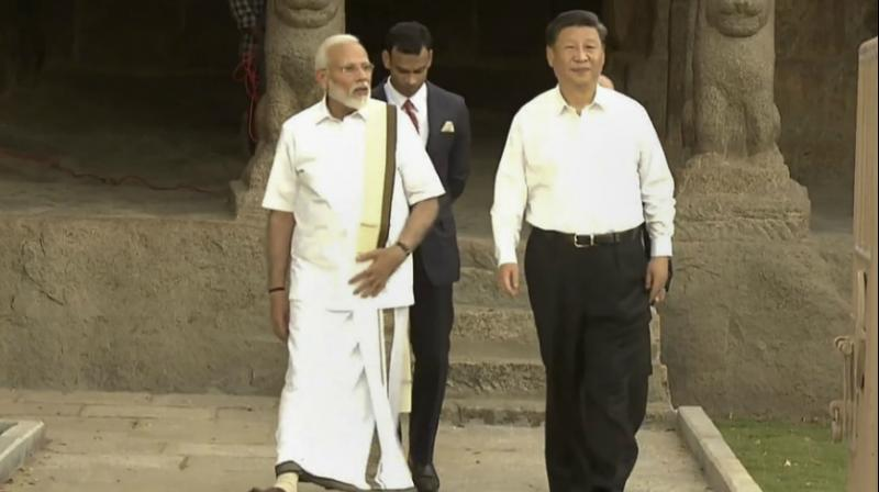 The Chinese leader wore a full sleeve white shirt and black trousers. (Photo: PTI)