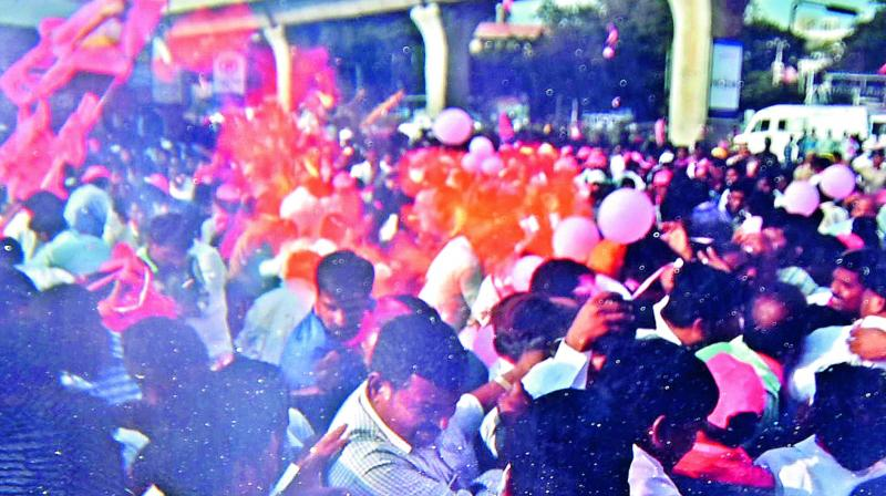 Hydrogen balloons carried by the TRS workers explode minutes before caretaker  minister K.T. Rama Rao's road show was scheduled to start near Uppal metro station where hundreds of TRS party supporters have gathered.