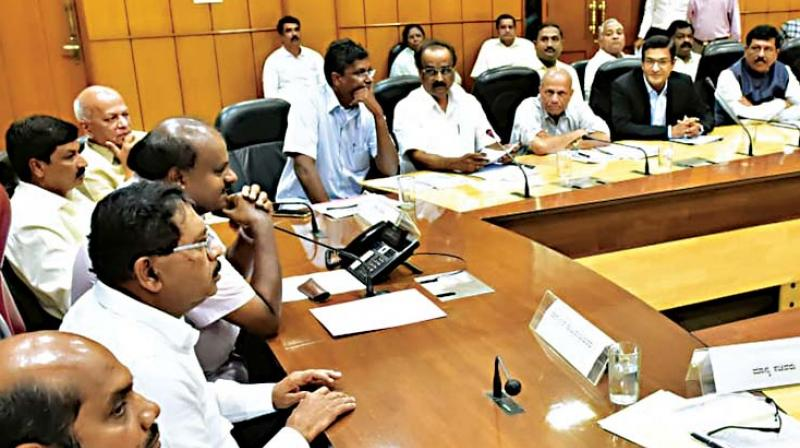 Chief Minister H.D. Kumaraswamy and Deputy Chief Minister G Parameshwar at a meeting of sugar factory owners in Bengaluru on Thursday Image: DC