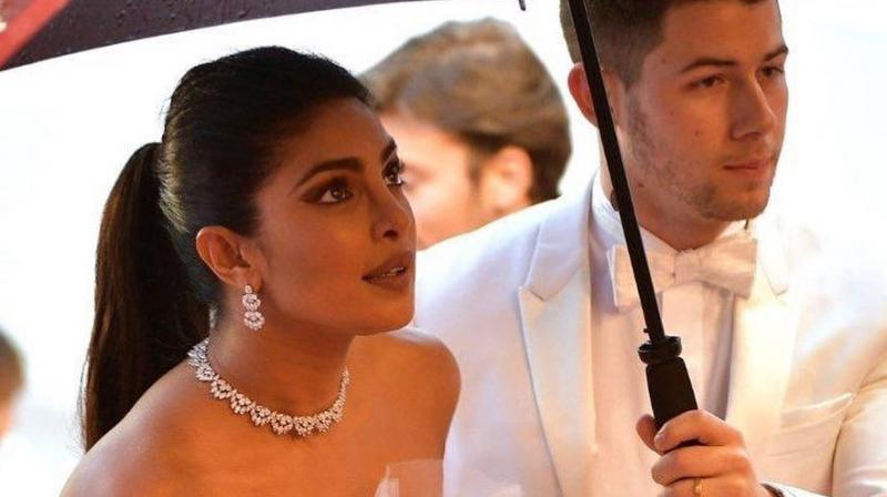 Priyanka Chopra Jonas and Nick Jonas made a dazzling appearance of the red carpet. She wore an off-shoulder ruffled Georges Hobeika dress. She wore beautiful Chopard jewels with the dreamy dress. (Photo: Instagram @priyankachopra)