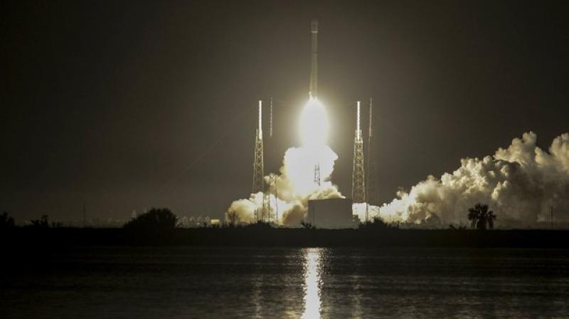The orbiting satellite is almost as big as a city bus. (Photo: AP)