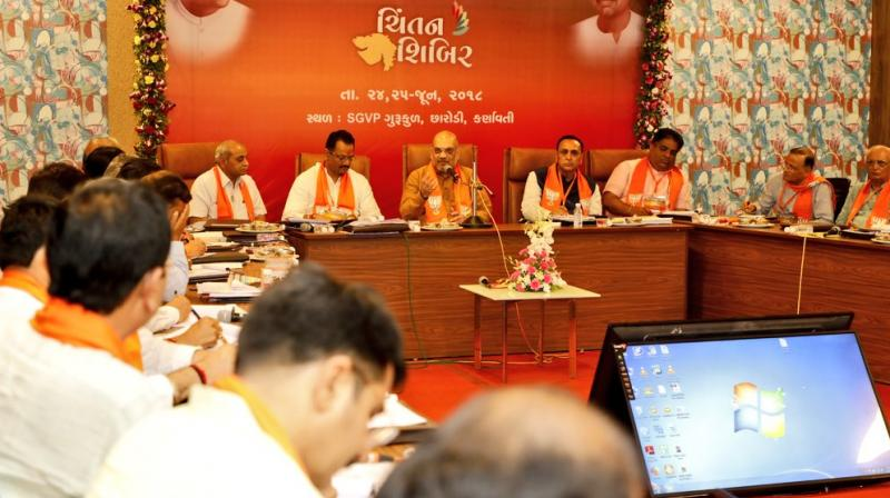 During the party's brainstorming session, BJP chief Amit Shah asked the party leaders to make people aware of the 'good work' done by the governments led by Narendra Modi at the Centre and Chief Minister Vijay Rupani in Gujarat, party sources said. (Photo: Twitter/@AmitShah)