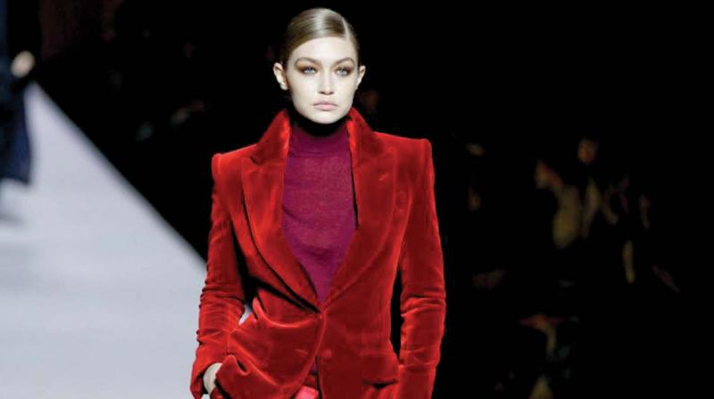 Gigi Hadid in a beautiful Burgandy Velvet Pant suit from Tom Ford's collection