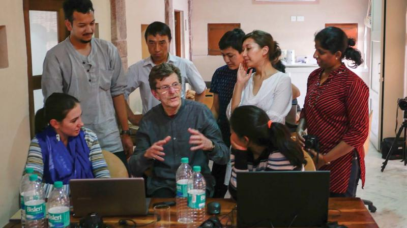 Photographer Neil Greentree teaches photography to Nagaur students.