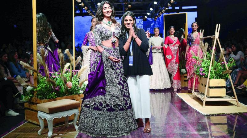 For a show stopping entry it was the gorgeous Pooja Hegde, in a heavily embellished purple scalloped hem lehenga and dupatta, while the tasselled plunging neckline of the choli was visually stunning.