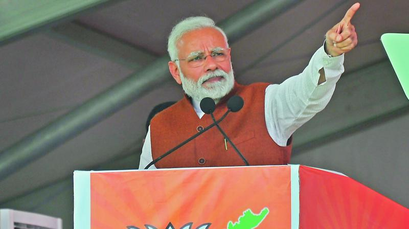 Prime Minister Narendra Modi addresses a BJP rally in Guntur on Sunday. (Photo: Tejo Roy)