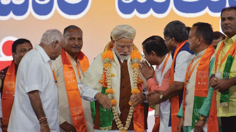 Prime Minister Narendra Modi with state BJP leaders at a party rally in Hubballi on Sunday (Photo: KPN(