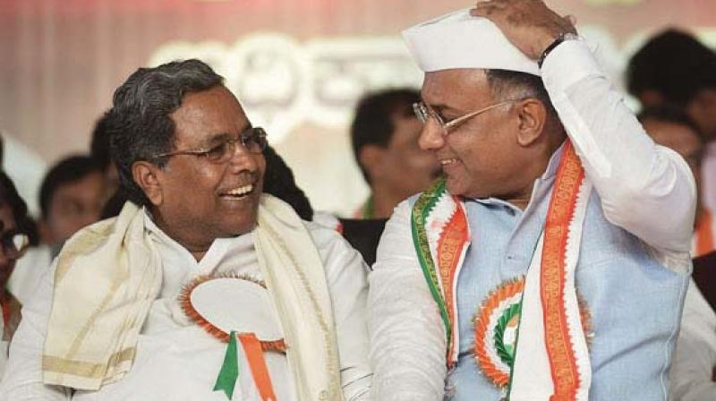 KPCC president Dinesh Gundurao with former chief minister Siddaramaiah in this file photo.