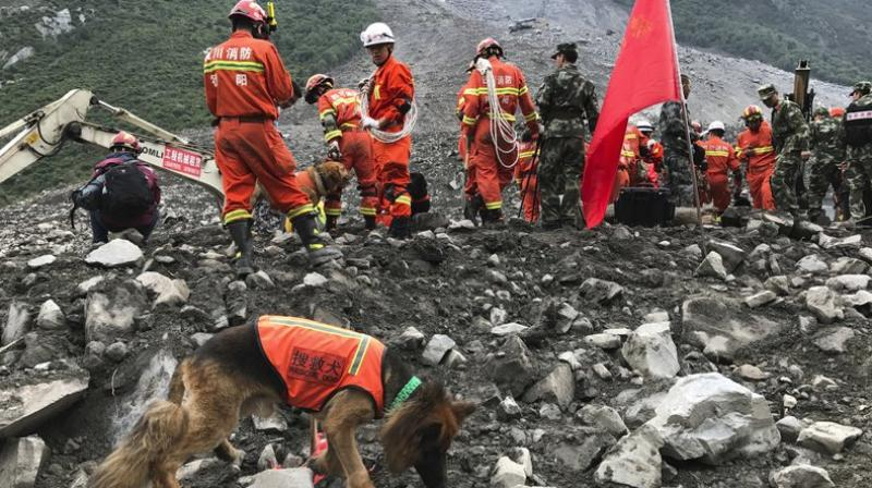 Chinese crews recovered nine bodies and were still searching for 109 others on Sunday, , a day after a massive landslide buried a picturesque mountain village in China. (Photo: AP)