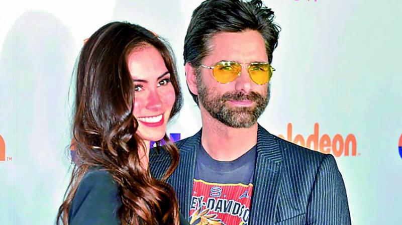 John Stamos marries fiancée Caitlin McHugh one day after jewelry robbery