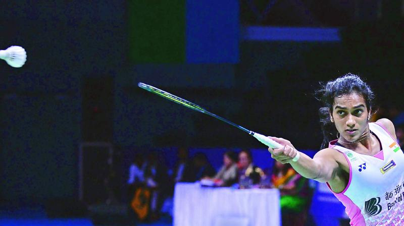 P.V. Sindhu returns a shot to Beiwen Zhang of USA in the India Open women's singles final in Delhi on Sunday. Sindhu lost 18-21, 21-11, 20-22.	— AFP