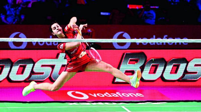 Carolina Marin of Hyderabad Hunters plays a shot during her trump match against Sun Ji Hyun of Delhi Dashers in their Premier Badminton League semifinal at the GMC Balayogi Stadium in Hyderabad on Friday night. (Photo: DC)