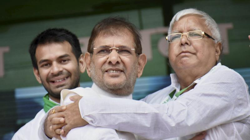 Ahead of his meeting, Sharad Yadav (M) accused the BJP of putting the country's unity at risk through divisive politics. (Photo: PTI)