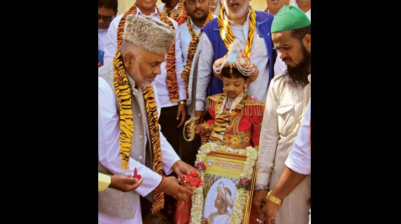 Tipu Sultan United Front members celebrate Tipu Jayanti near Summer Palace in Bengaluru on Friday. (Photo: DC)