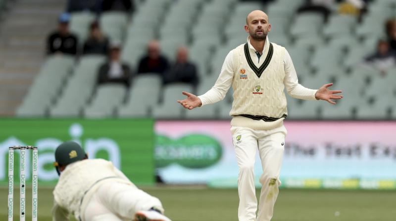 Spin king Nathan Lyon removed dangerous half-century makers Shan Masood and Asad Shafiq Monday as Australia edged closer to victory inside four days at the second Test in Adelaide despite stubborn Pakistan resistance. (Photo:AP)