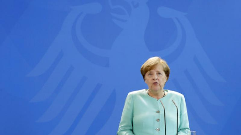 Merkel wants to seal coalition deal with SPD swiftly