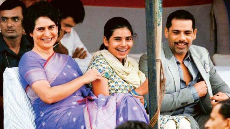 Priyanka Gandhi with daughter Miraya and husband Robert Vadra in a file photo.