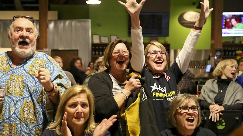 Voters react as they watch the results slowly trickle in on Wednesday. (Photo: AP)