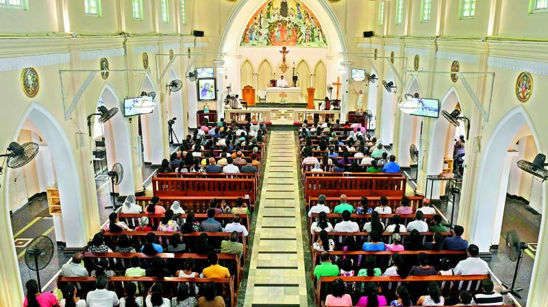 Sri Lankan Catholic devotees pray during a Mass at the St Theresa's church as the Catholic churches hold services again after the Easter attacks in Colombo on Sunday. (Photo - AFP)
