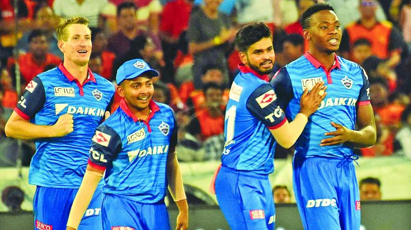 Kagiso Rabada (right) celebrates a Sunrisers wicket with his Delhi teammates during their IPL match in Hyderabad on Sunday. (P. Surendra)