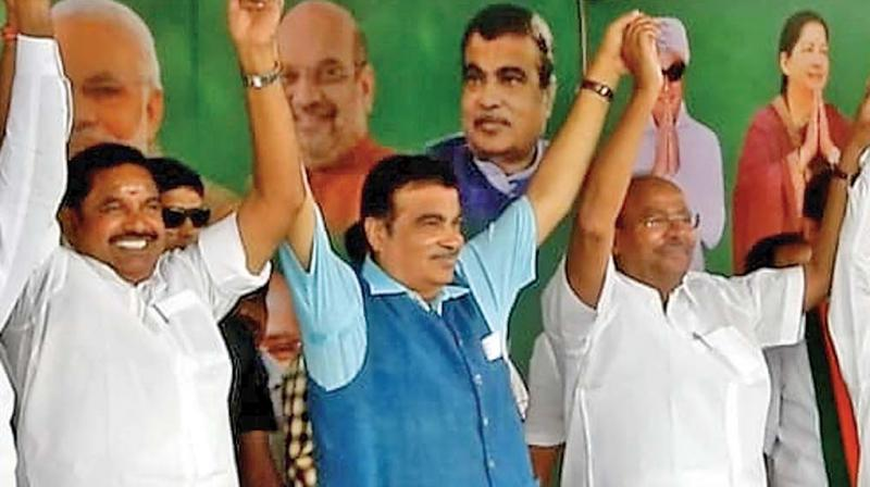 Union minister Nitin Gadkari (second left), Chief Minister E. K. Palaniswami (first left) and PMK chief S. Ramadoss  during an election campaign rally in Salem on Sunday. (DC)