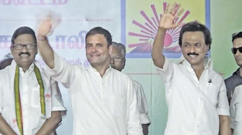 Congress president Rahul Gandhi, flanked by DMK chief M.K. Stalin and TNCC president  K .S. Alagiri, waves at the crowd at an election rally in Salem. (DC)