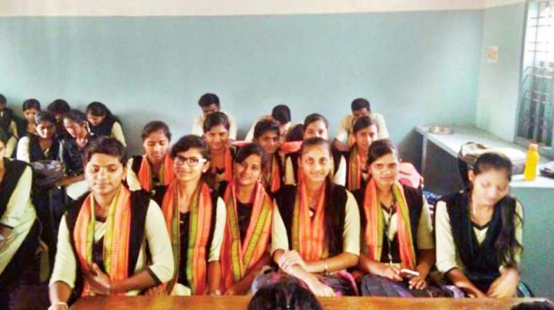 Students attend classes wearing saffron shawls at the Government First Grade College in Koppa of Chikkamagaluru