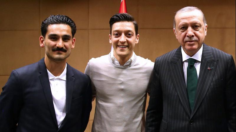 Ilkay Gundogan and Mesut Ozil, who were born in Gelsenkirchen to Turkish parents, were jeered and whistled by fans during pre-World Cup friendlies after posing for a photo alongside Turkish President Recep Tayyip Erdogan. (Photo: AFP)