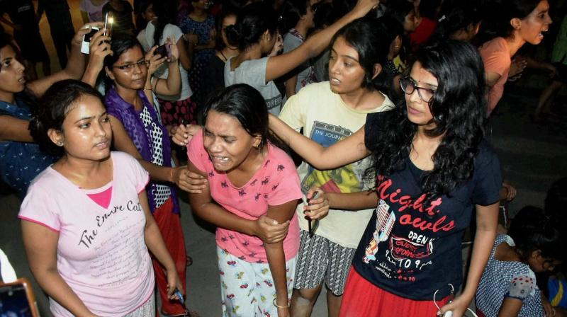 An injured student writhing in pain after police allegedly beat them up during a clash at Banaras Hindu University late Saturday night. (Photo: PTI)