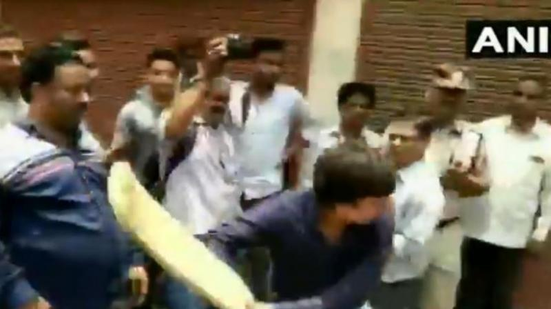 BJP MLA Akash Vijayvargiya was caught on camera thrashing a Municipal Corporation Officer who was in the area for an anti-encroachment drive. (Photo: ANI)
