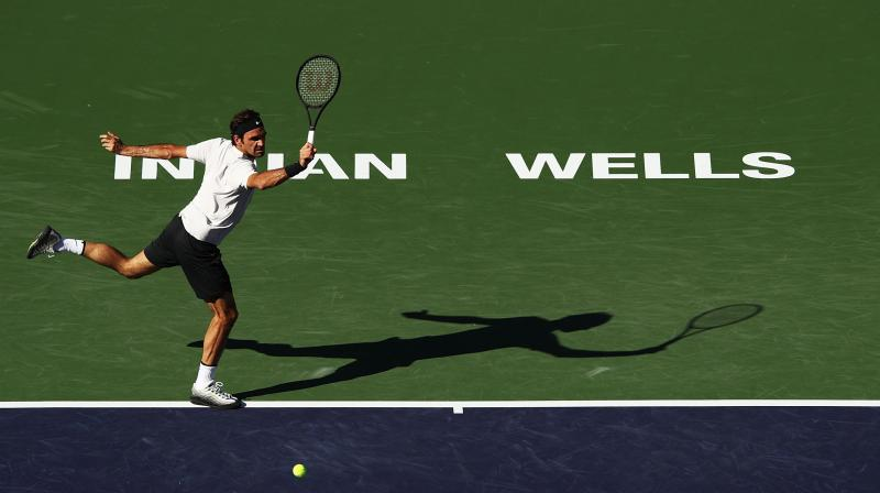 Roger Federer led 6-3, 2-2 when the match was delayed by a heavy drizzle 56 minutes after it began. (Photo: AFP)