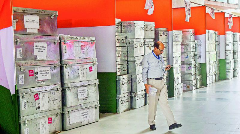 An official walks past the boxes containing election material at a counting hall ahead of the counting process for the Lok Sabha elections in New Delhi on Wednesday. (Photo: AP)