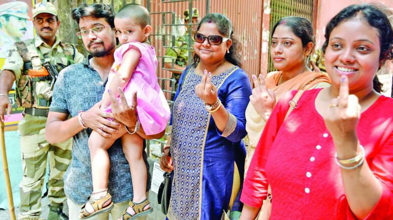 Voters show their fingers marked with indelible ink after casting their votes at the polling station as the Election Commission of India (ECI) ordered for re-polling in Kolkata Uttar parliamentary constituency on Wednesday. (Photo: ANI)