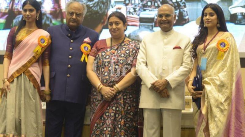 Boney Kapoor with daughters Janhvi, Khushi, President Ram Nath Kovind and I&B Minister Smriti Irani.