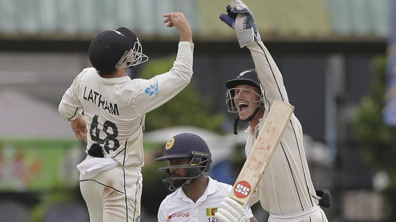 Needing 187 runs in the second innings to make New Zealand bat again, Sri Lanka was bowled out for 122 runs in the final session despite a fighting 51 off 162 deliveries from wicket-keeper Niroshan Dickwella. (Photo:AP/PTI)