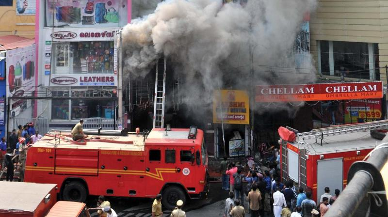 Smoke billows from the two-storey building which caught fire on Tuesday