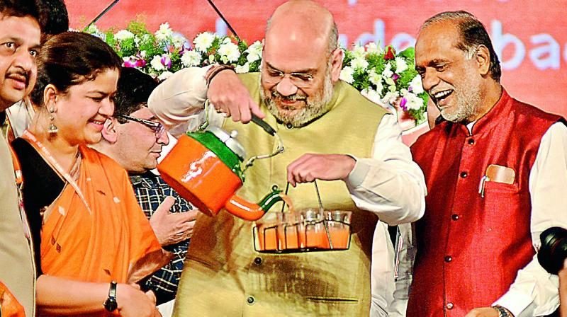 BJP president Amit Shah serves tea as BJYM national chief Poonam Mahajan and BJP TS president Dr K. Laxman look on at the BJYM Mahadhivesan at Parade Grounds, Secunderabad, on Sunday.(Photo: S. Surender Reddy)