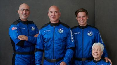 Amazon.com and Blue Origin founder Jeff Bezos (centre), his brother, Mark Bezos (left), Oliver Daemen (right) and Wally Funk (seated) experienced about three minutes of weightlessness during their first space flight on Tuesday. (Photo: Twitter/ @blueorigin)