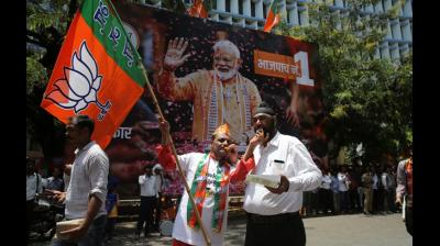Bharatiya Janata Party (BJP) workers distribute sweets as they celebrate outside the party headquarters in Mumbai, India, Thursday, May 23, 2019. Indian Prime Minister Narendra Modi and his party were off to an early lead as vote counting began Thursday following the conclusion of the country's 6-week-long general election, sending the stock market soaring in anticipation of another five-year term for the Hindu nationalist leader. (AP)