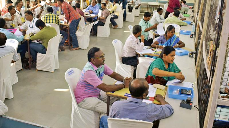 Vote counting process on full swing at Dr Mahalingam College of Engineering and Technology in Pollachi on Thursday.   —DC