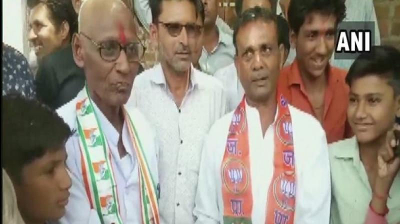 Sen, who shaved his head in front of the people of Harana village in Rajgarh, attributed this defeat to party's unfulfilled promise of loan waivers to the farmers. (Photo: ANI)