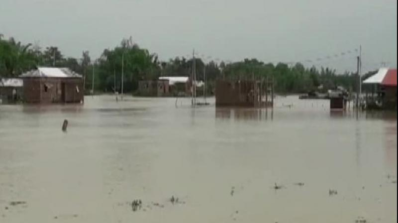 Heavy rains leading to flash flood have left hundreds of houses submerged in North Tripura, Unakoti and Dhalai districts of Tripura. (Photo: Twitter/ ANI)