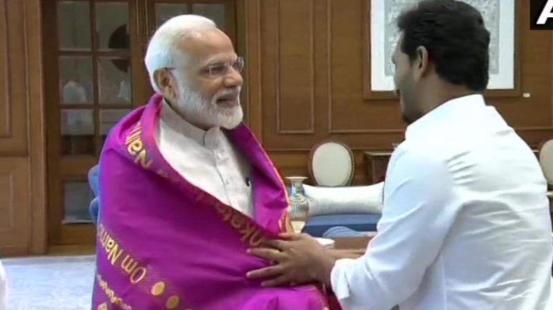 YSR Congress Party president and Andhra Pradesh Chief Minister-designate Y S Jagan Mohan Reddy met Prime Minister Narendra Modi. (Photo: Twitter/ ANI)