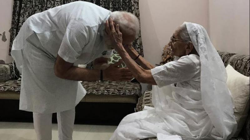 Four days before taking oath as Prime Minister for a second term, Narendra Modi on Sunday visited his mother Heeraben Modi to seek her blessings. (Photo: ANI)