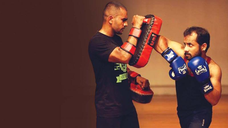 Bivin K (right) sparring with a partner