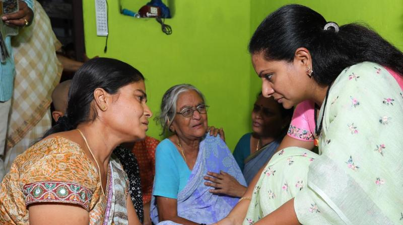 Former MP K. Kavitha consoles family members of TRS activist Kishore of Manchippa village in Nizamabad district on Monday. Kishore died of cardiac arrest following LS poll results.
